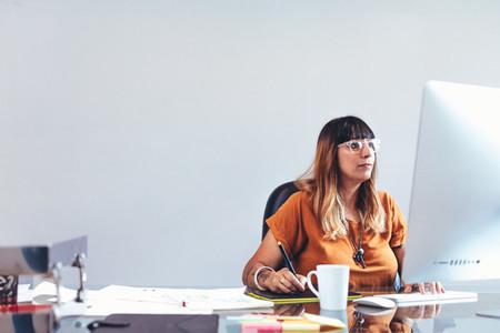 Female artist working in office