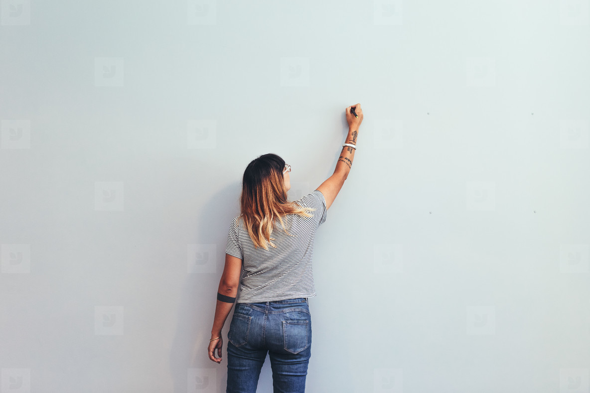 Artist making a sketch on a wall