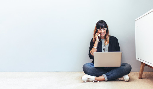 Woman entrepreneur managing business from home