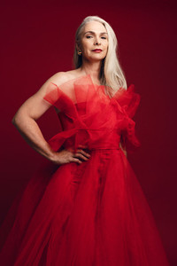 Glamorous senior woman in red dress