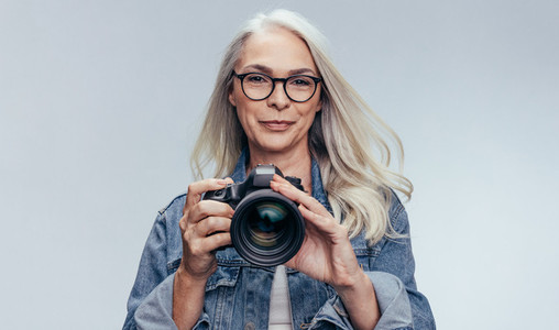 Porfessional female photographer during a photo shoot