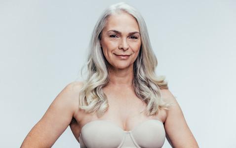 Confident senior woman in lingerie