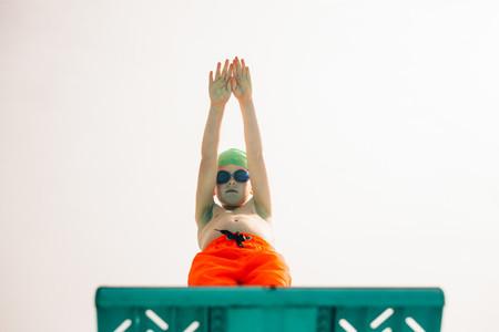 Boy preparing to dive