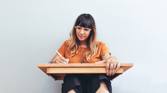 Close up of an illustrator working on her drawings