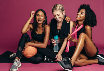 Group of women taking break after workout