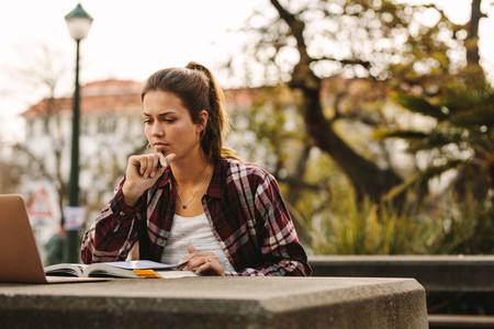 Female student preparing notes for exams