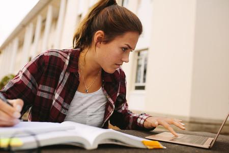 Female student preparing for exams at campus