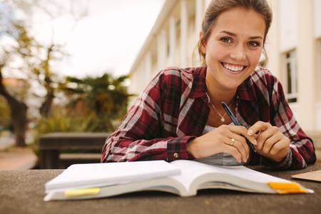 Girl student studying at university campus