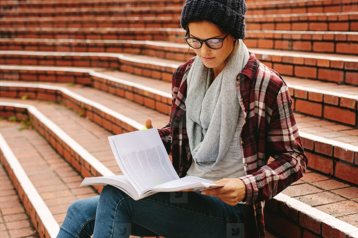 Student studying at college campus