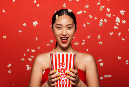 Woman enjoying a movie with popcorn