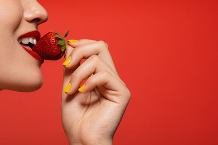 Having a strawberry bite