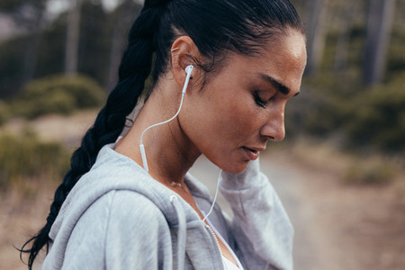 Runner listening music during outdoors workout