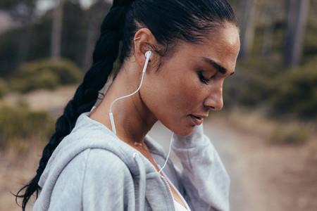 Runner listening music during outdoors workout