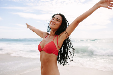 Woman enjoying spending time on the beach