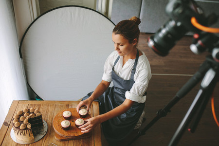 Feamle baker making a video blog