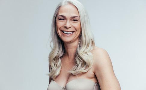 Cheerful mature female in lingerie