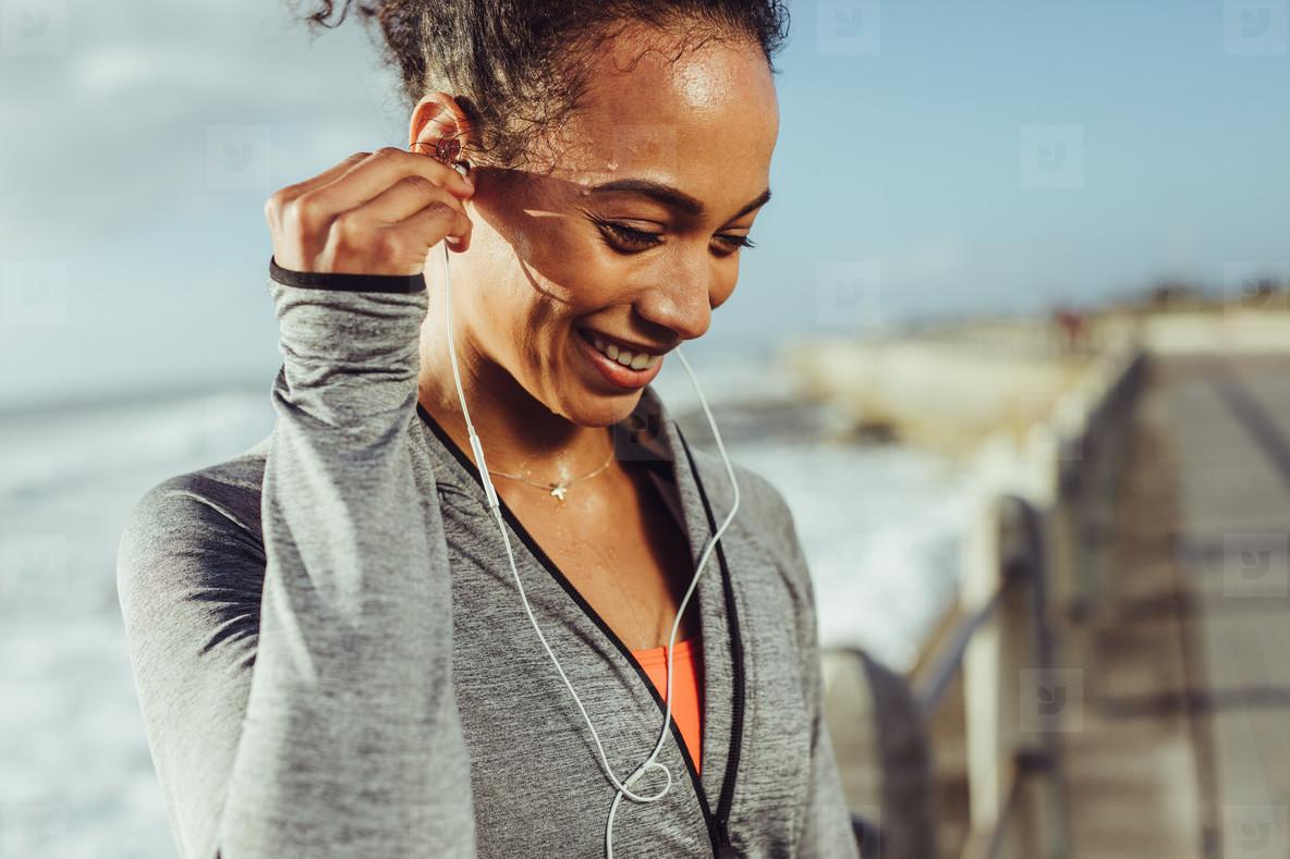 Runner listening to music while exercising