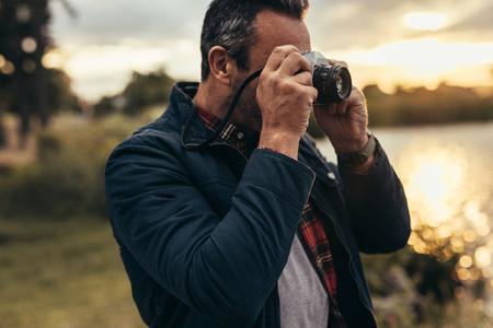 Tourist taking photos of nature