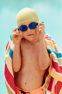 Boy drying off after swimming lessons