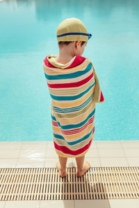 Boy drying off from swimming