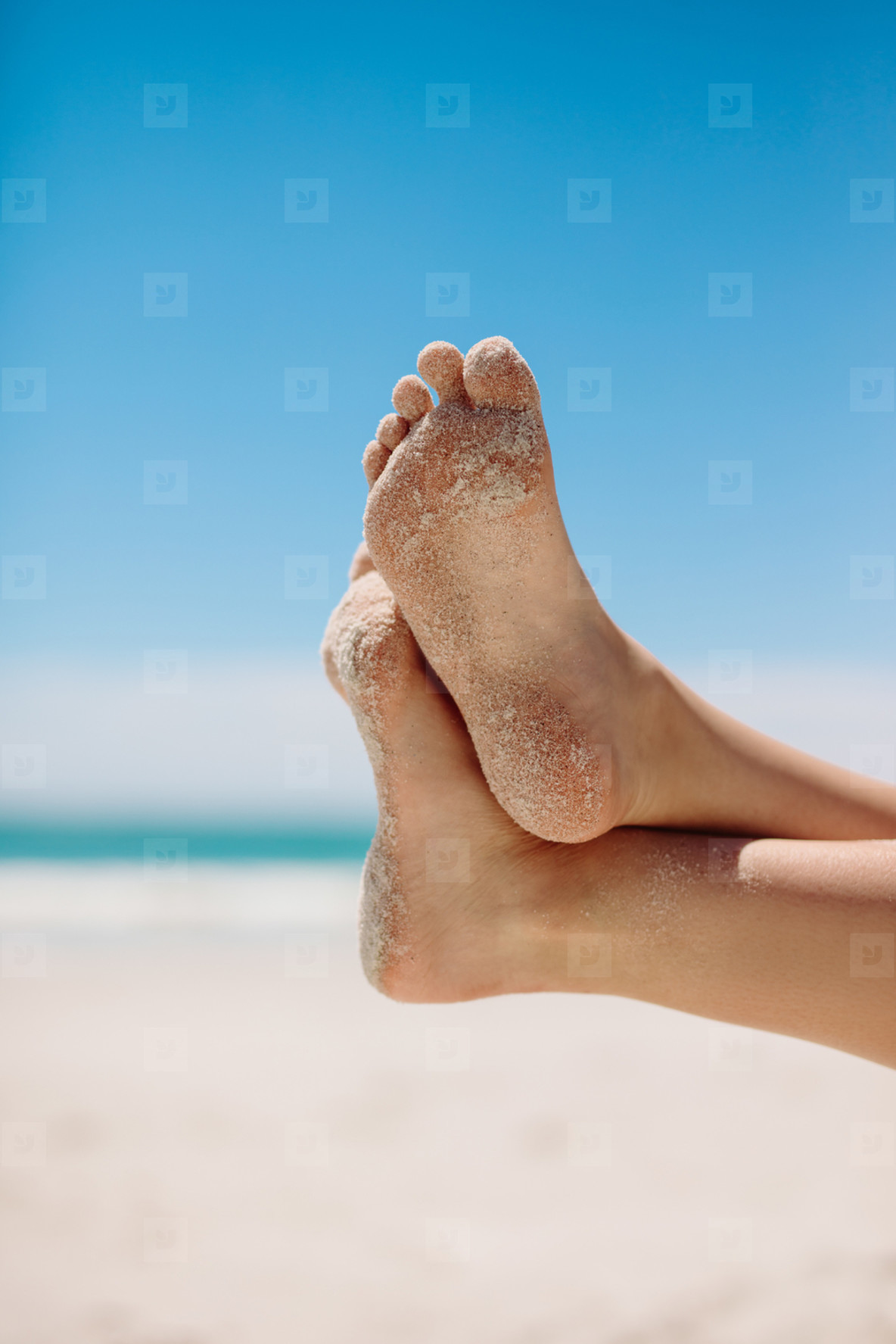 Feet in a relaxed position at the beach