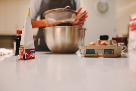 Pastry chef preparing cake
