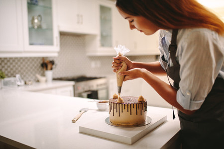 Pastry chef decorating chocolate cake