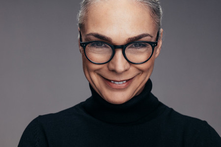 Positive senior woman with eyeglasses