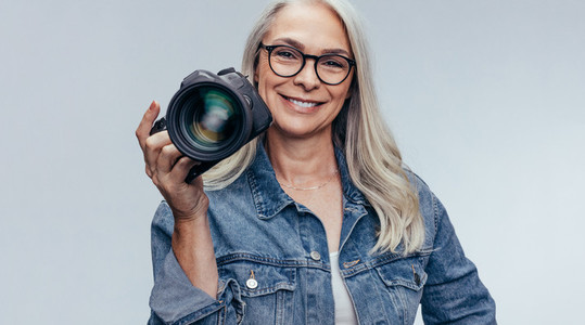 Professional female photographer with dslr camera