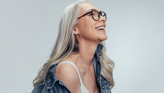 Cheerful senior woman looking at copy space