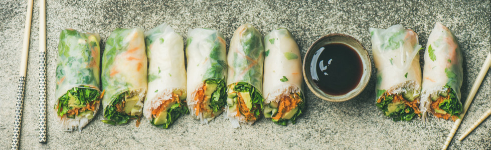 Flat lay of vegan spring  summer rice paper rolls  wide composition