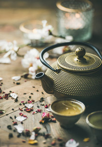 Traditional Asian tea ceremony arrangement over rustic background