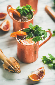 Blood orange Moscow mule alcohol cocktails in mugs