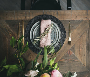 Flat lay of Spring Easter Table setting over vintage wooden background