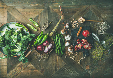 Winter vegetarian or vegan food cooking ingredients over wooden background