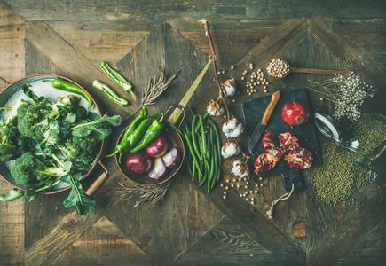 Winter vegetarian or vegan food cooking ingredients over wooden background