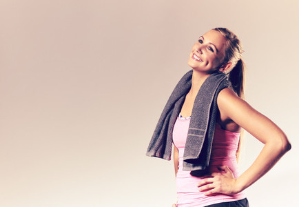 Woman wearing workout clothes posing with head tilted back
