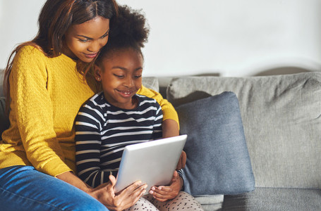 Black mom and child with tablet