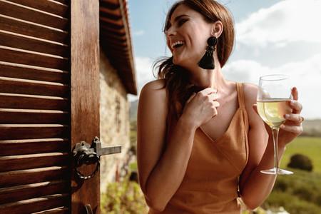 Woman on a holiday enjoying wine