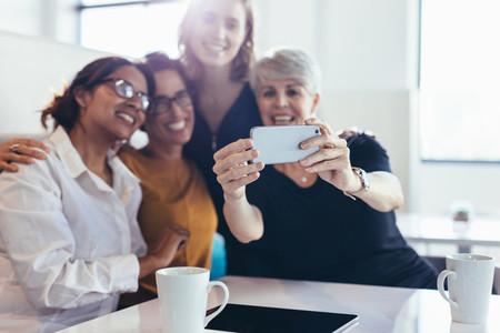 Group of businesswomen taking selfie