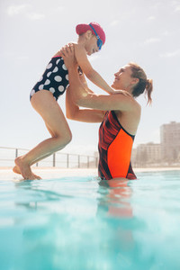 Mother and daughter at outdoor pool