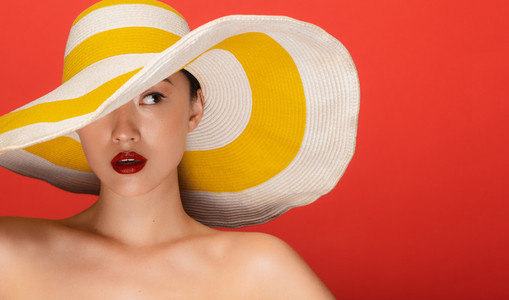 Attractive woman with summer hat