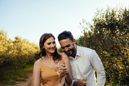 Romantic couple walking in a wine farm