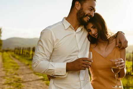Romantic couple walking in a vineyard