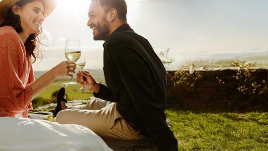 Couple on a date near a wine farm drinking wine