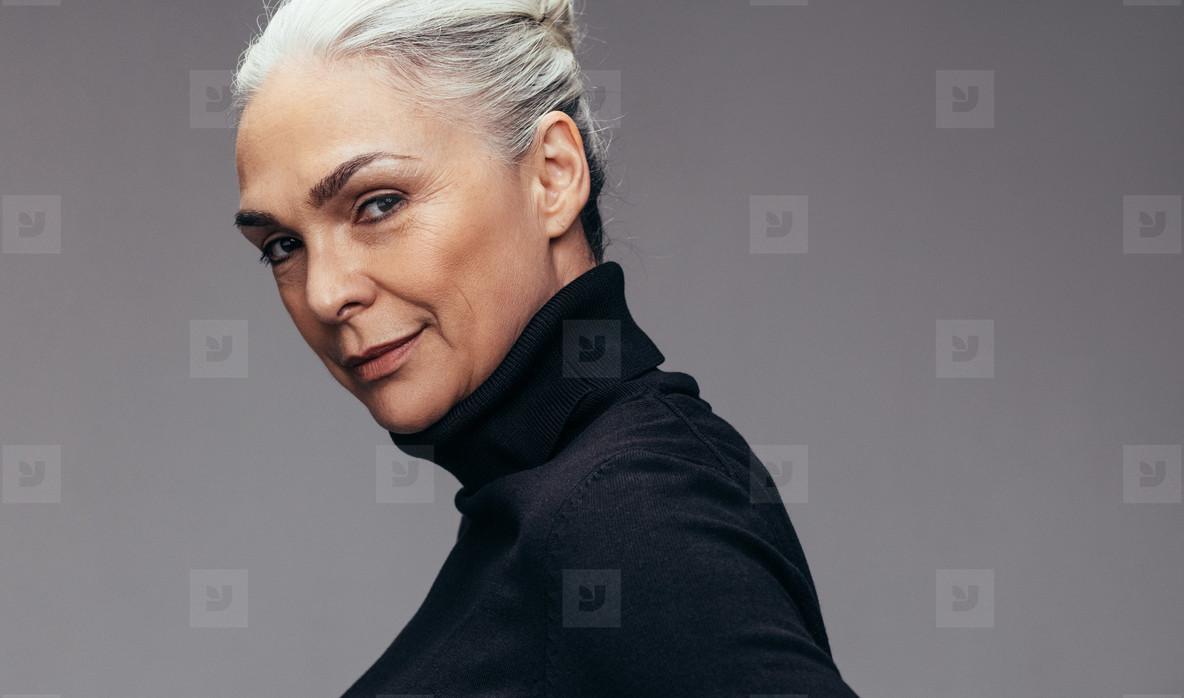 Beautiful mature woman in staring at camera