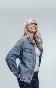 Stylish senior woman looking at copy space