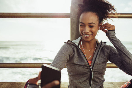 Runner enjoying listening to music