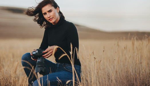 Woman doing landscape photography outdoors