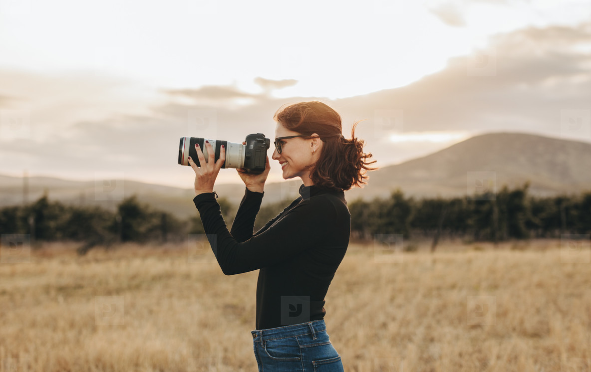 Female photographer shooting outdoors
